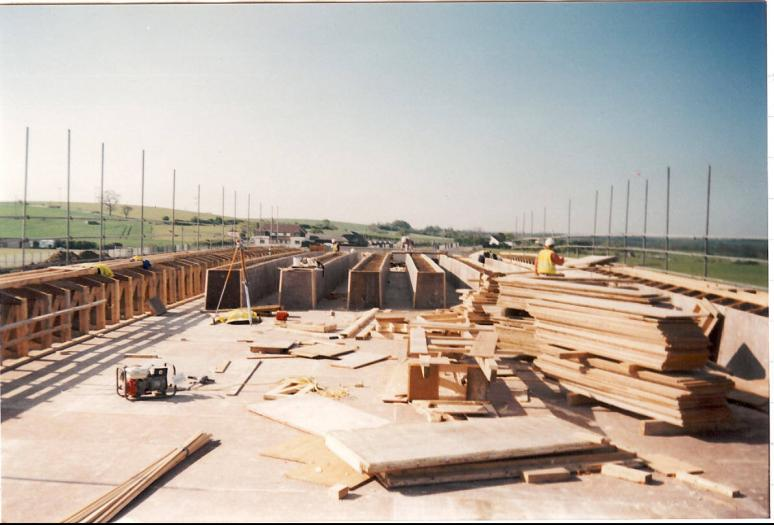 Central timber coffins being set up on the deck along with the edge formwork.