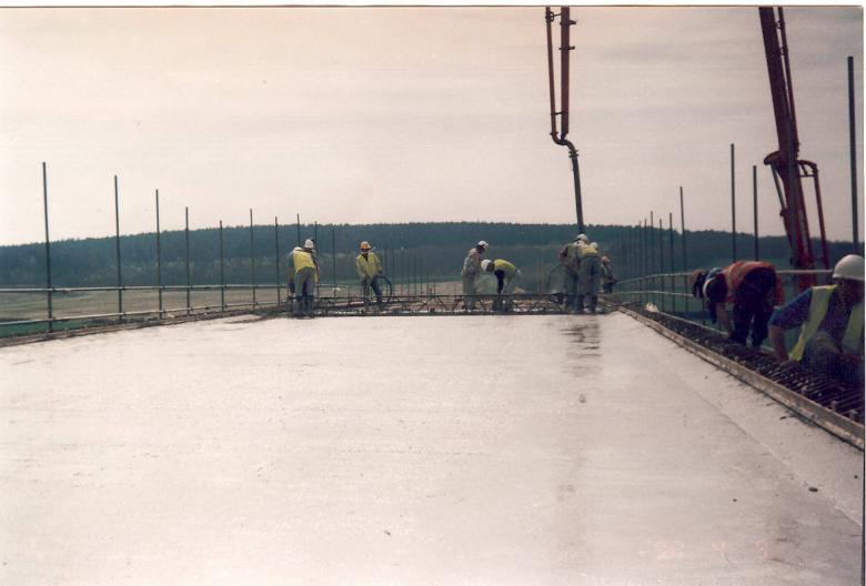 Bridge deck being cast - screed being used to level the deck.