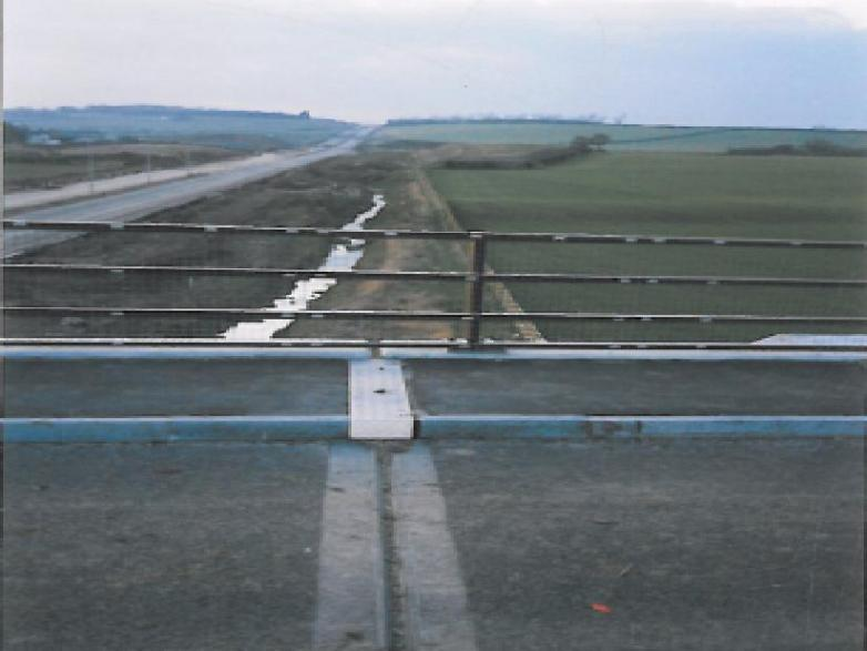 bridge joint installed - cover plate on the footpath